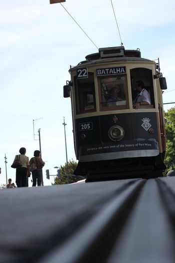 Close-up of overhead cable car against sky