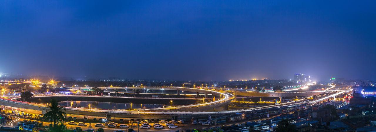Panoramic Shot Of Illuminated Bridges Against Sky At Night
