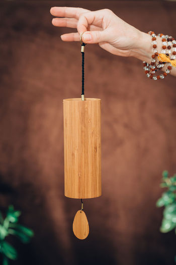 Koshi chime, sound therapy instrument Brown Background Chimes Hands Meditation Music Relaxing Sound Of Life Spirituality Wind Chimes Balance Chime Holding Holistic Holistichealing Human Hand Instrument Koshi Mantra Music Instrument Sound Bath Sound Healing Sound Therapy Stress Relief Toned Image Wood - Material