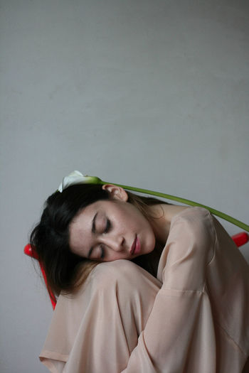 Portrait of young woman with eyes closed