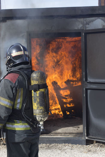 Side view of firefighter working outdoors