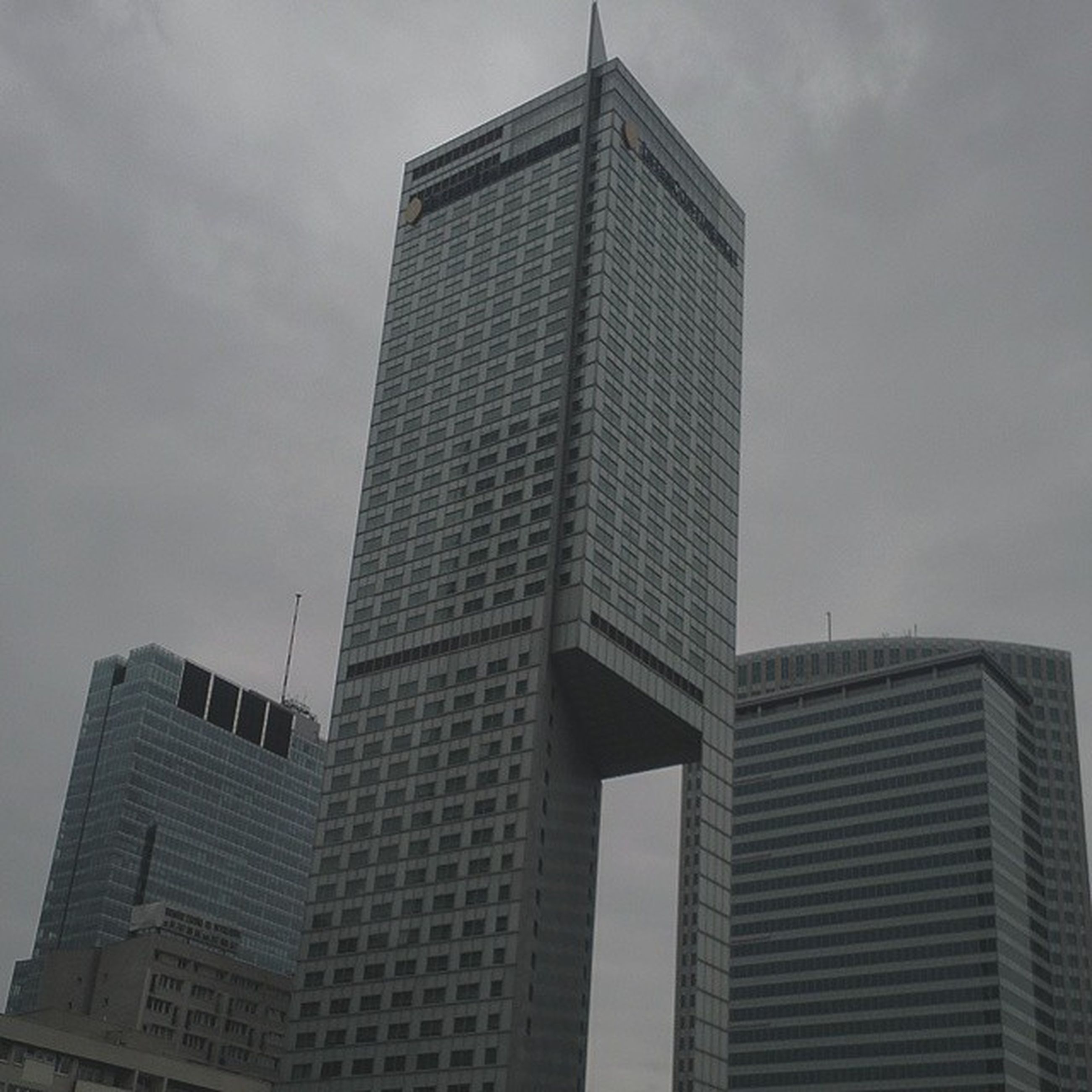 architecture, building exterior, built structure, low angle view, sky, tall - high, city, skyscraper, modern, office building, tower, cloud - sky, building, tall, cloudy, cloud, day, outdoors, no people, glass - material