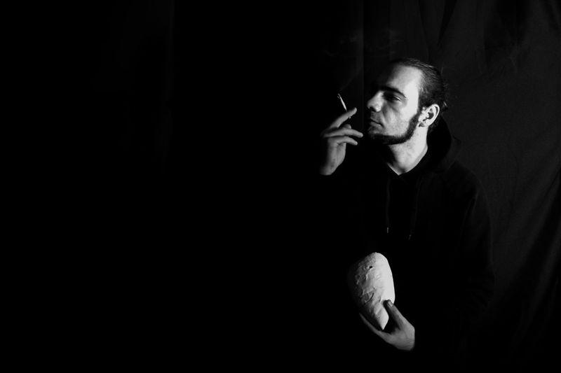 Portrait of mature man smoking