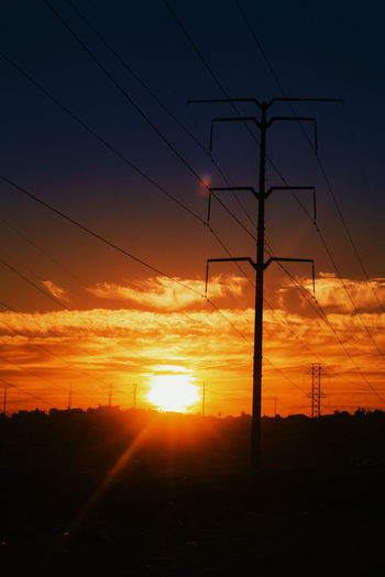 Beauty In Nature Bright Cable Cloud Cloud - Sky Dramatic Sky Electricity  Electricity Pylon Landscape Lens Flare Orange Color Outdoors Outline Pole Power Line  Power Supply Scenics Silhouette Sky Sun Sunbeam Sunlight Sunset Tranquil Scene Tranquility