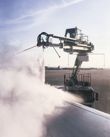 Airport Cloud - Sky Construction Equipment Construction Industry Construction Machinery Crane - Construction Machinery Day Defrost Defrosting Development Industrial Equipment Industry Machinery Metal Motion Nature No People Outdoors Pipe - Tube Pollution Sky Smoke - Physical Structure Transportation