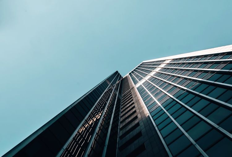 - A = ARCHITECTURE - Check This Out EyeEm Best Edits Office Building Architecture Architecture_collection Built Structure Architecture Building Exterior Building Sky Low Angle View City Office Building Exterior Modern Tall - High Skyscraper Office No People Clear Sky Tower Day Outdoors Blue