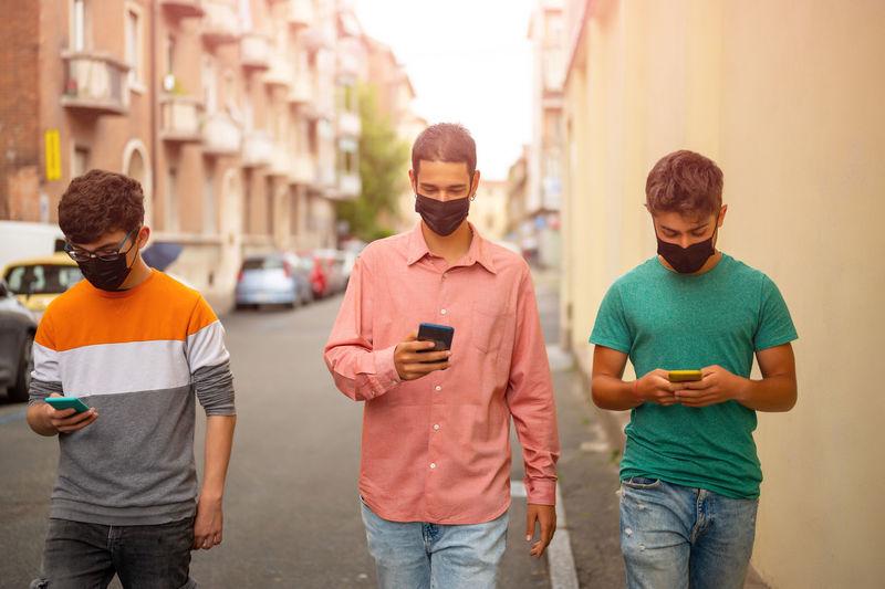 Men standing on city street