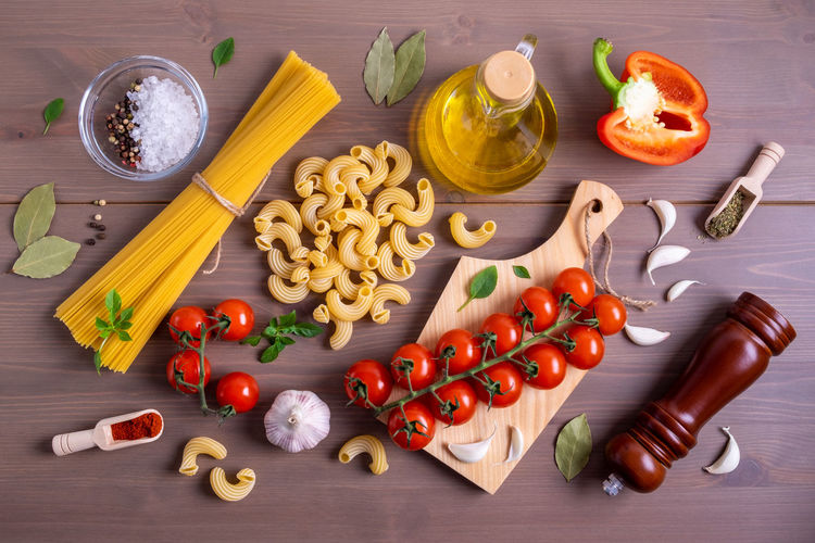 High angle view of fruits and vegetables on cutting board