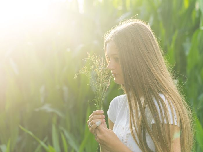One Person Side View Blond Hair Sunlight Long Hair Young Women Young Adult Outdoors Day Real People Nature Leisure Activity Happiness Lifestyles Women Smiling Plant Beautiful Woman Growth Tree
