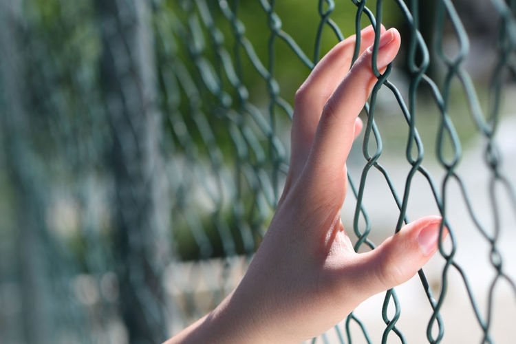 Barrier Boundary Chainlink Fence Close-up Female Fence Hand Human Body Part Human Hand Leisure Activity Mental Nature Outdoors Protection Security Trapped