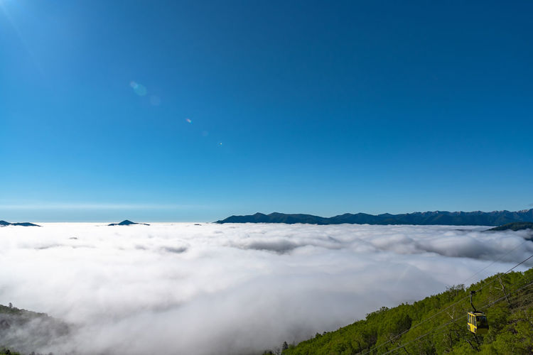 Panorama view from Unkai Terrace in summer time sunny day. Take the cable car at Tomamu Hoshino Resort, going up to see the sea of clouds. Shimukappu village, Hokkaido, Japan Unkai Terrace Sea Of clouds Clouds Cloud - Sky Tomamu Hoshino Resort Cable Car Cableway Ropeway Walking Popular Photos Attraction Panorama Beautiful Beauty In Nature Sky Famous Mountain Nature Landscape Summer Sun Sunny Destination Scenery Tourism Tourist Scenics Travel Trip Vast Peak Aerial View Vacations Valley Blue Above Gondola Shimukappu Hokkaido Japan ASIA Village Alphabet Copy Space View Day Outdoors