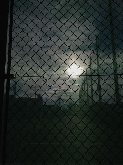 View of chainlink fence at dusk
