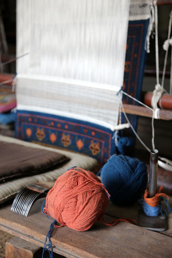 Traditional Pattern Traditional Culture Blue Red Yarn Roll Yarn Weaves Touristic Carpets Weaver Traditional Weave Weaving Web Woman's Hands Weaving Weaving Weaving Machine Weaving Loom Weaving Utensils Weaving Comb Craftsmanship  Craftwork Woman Weaves A Carpet Woman's Hands Asian Culture Nepali  Patan Nepal