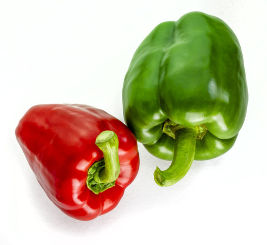 Close-up of red bell pepper against white background