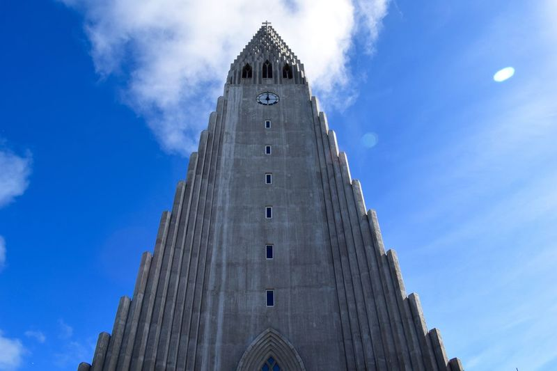Hallgrìmskirkja Reykjavik Architecture Bell Tower Blue Building Exterior Built Structure Clock Clock Tower Day History Low Angle View No People Outdoors Place Of Worship Religion Sky Spirituality Time Tower