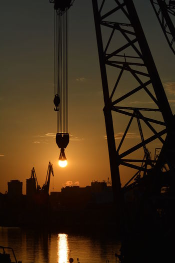 Silhouette Of Crane At Sunset