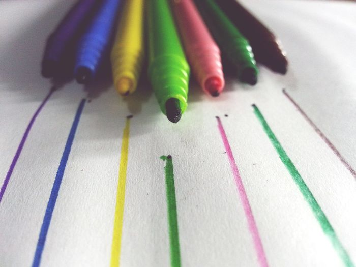 Close-up of colorful fell tip pens arranged on paper