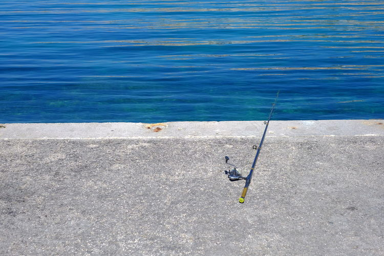 High angle view of fishing rod at sea