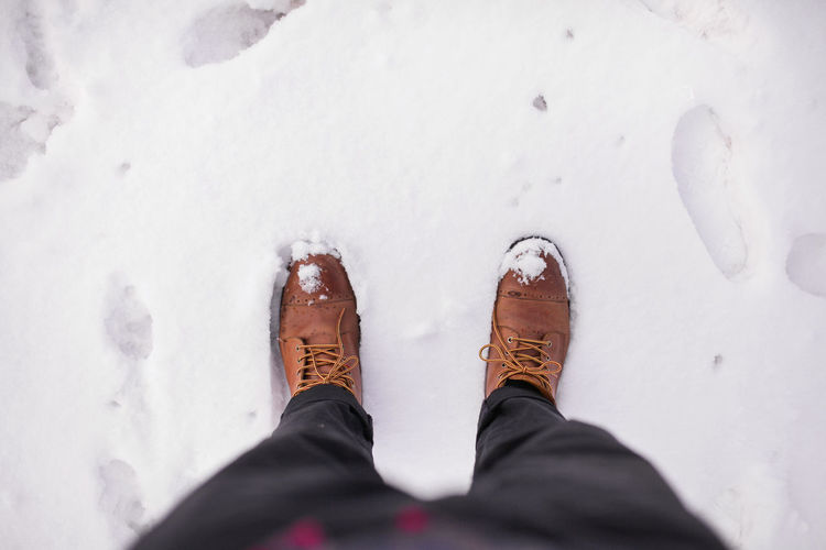 Winter boots on icy ground. Low Section Human Body Part Shoe Human Leg Body Part One Person Cold Temperature Snow Personal Perspective Winter Standing High Angle View Real People Men White Color Day Land Field Human Limb Outdoors Human Foot Jeans White Background Winter Boots Ice