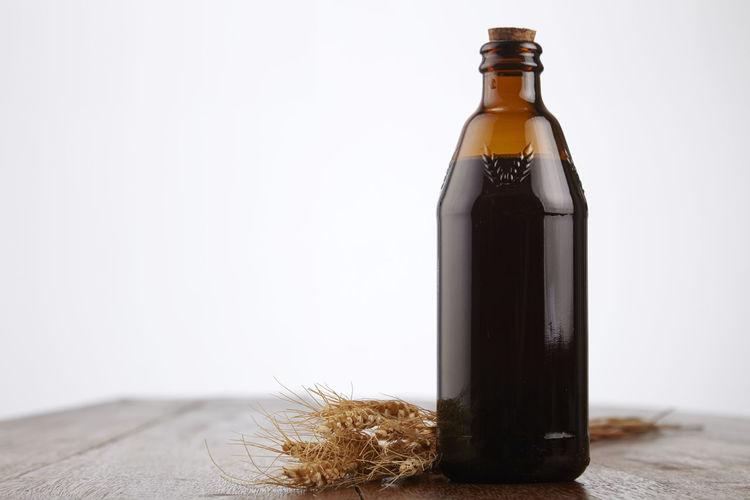 malt vinegar on the wooden table Acid Black Vinegar Bottle Condiments  Container Cooking Culinary Dressing Flavor Flavour Food Glassware Healthy Ingredient Liquid Malt Malt Vinegar Organic Salad Vinegar Wooden Table