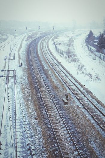 Where are you heading? Railway Gloam Snow Train Station Inner Mongolia Train Tracks Long Way Frozen Temperature Dual Tracks Forest Winter Traffic Lights Fence