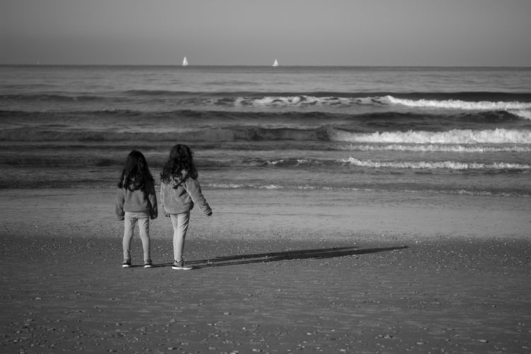 2 Girls Beach Photography Black & White Kids Beach Beachphotography Beauty In Nature Black And White Black And White Photography Blackandwhite Blackandwhite Photography Friendship Girls Horizon Over Water Monochrome monochrome photography Sea Seaside Sky Standing Togetherness Two Girls Two People Water Wave