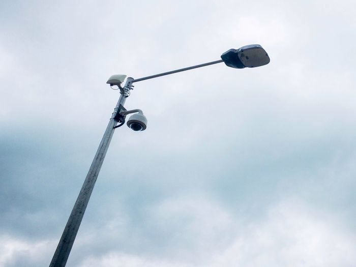 CCTV camera under a street light. Paranoia Safety Intelligence Surveillance Surveillance Camera Cctv Cam CCTV Equipment Cctv CCTV Camera And Post With Building Behind Out Of Focus Cctv Camera EyeEm Selects Low Angle View Lighting Equipment No People Technology Communication Sky Day Outdoors