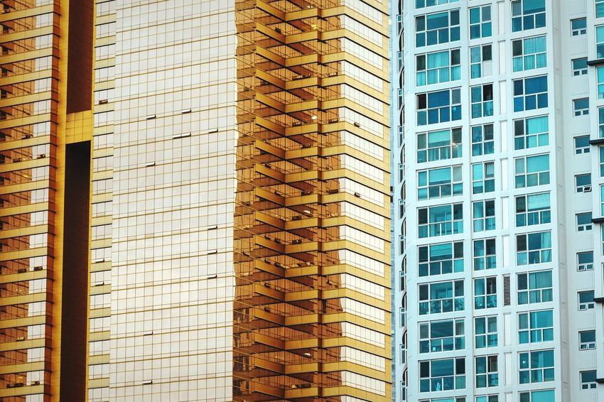Gold and Sapphire Residential Building Apartment Gold Golden Built Structure Architecture Building Exterior No People Pattern City Low Angle View Exterior Curtain Walls Window Windows Modern Busan Korea Contrast Residential Structure Office Building Office Reflection Urban Geometry Geometric Shape