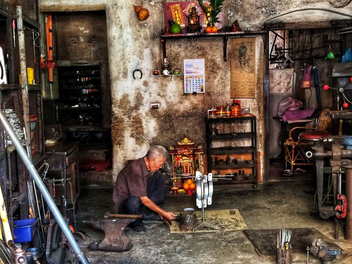 Foundry Handwork Doing Design Doing Creation Workmanship Workshop Concentrated Industry Working Workshop Apron Real People Occupation Kitchen One Person Indoors  One Man Only Adult People Metal Industry Day The Street Photographer - 2018 EyeEm Awards