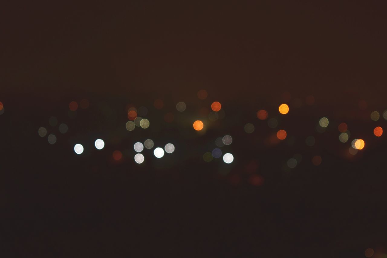illuminated, night, defocused, no people, light effect, outdoors, black background, sky, close-up