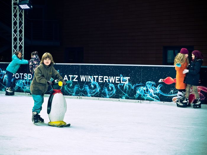 Full Length Boys Sport Child Friendship Competition Winter Sport Leisure Activity Lifestyles Night Outdoors People Skill  Ice Rink Winter Competitive Sport Portrait Ice Skate Capture Berlin Olympus Berlin Germany Candid Streetphotography Snow Sports