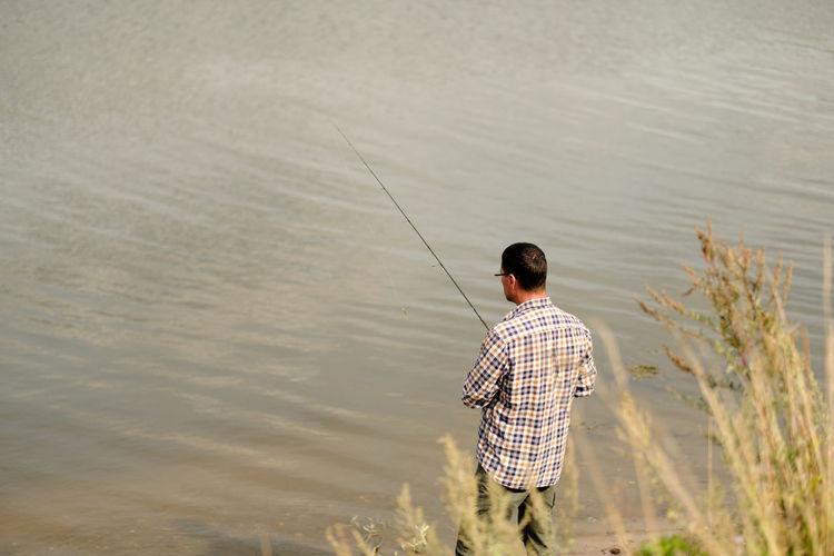 Fisherman in bushes