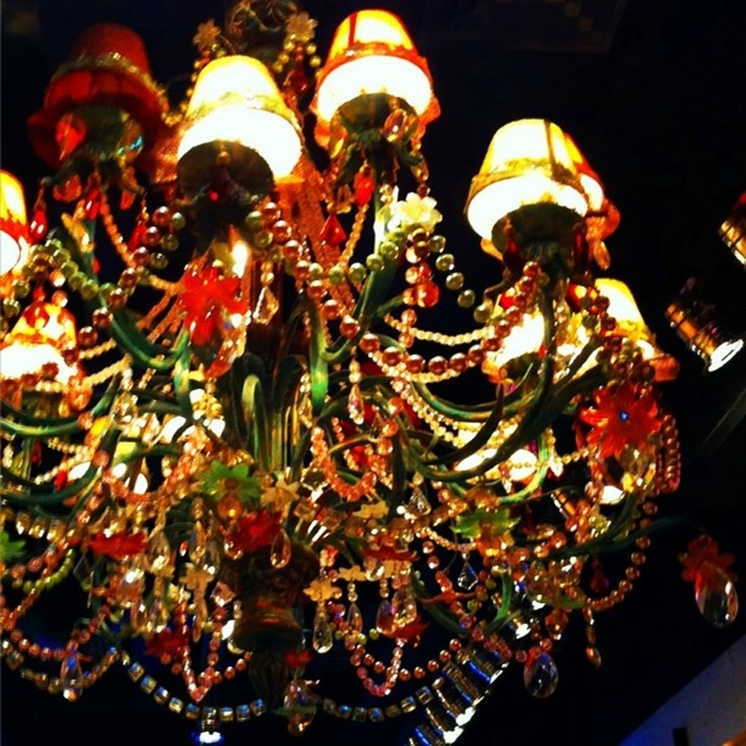 indoors, illuminated, decoration, hanging, celebration, tradition, cultures, christmas, night, christmas decoration, religion, lighting equipment, low angle view, christmas lights, spirituality, decor, red, traditional festival, place of worship