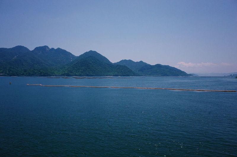 Japan Miyajima Beauty In Nature Blue Clear Sky Copy Space Day Idyllic Mountain Mountain Range Nature No People Non-urban Scene Outdoors Scenics - Nature Sea Sky Tranquil Scene Tranquility Water Waterfront