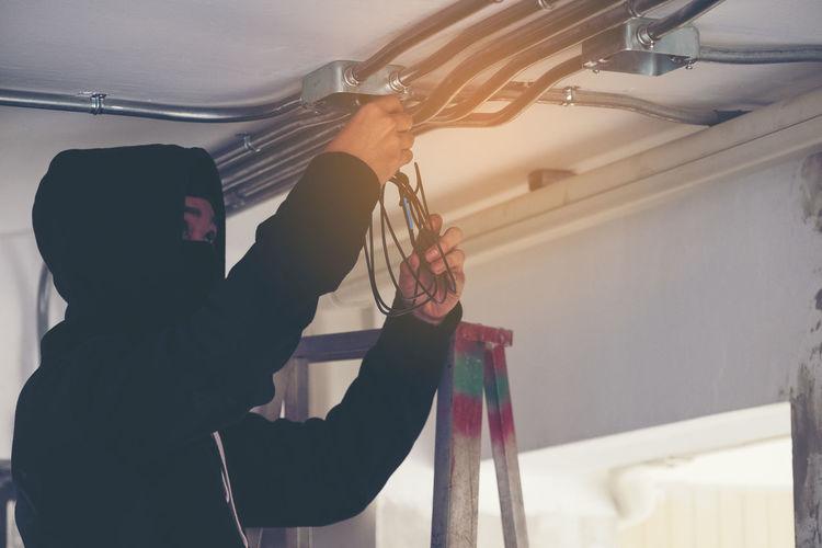 Burglar installing in cables