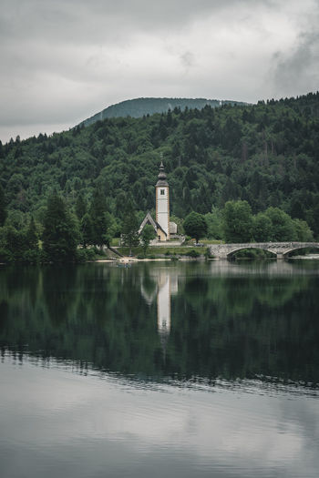 Church at lake Bohinj in Slovenia Calm Church Nature Quiet Places Rain Slovenia Weather Architecture Beauty In Nature Bohinj Built Structure Cludy Lake Moody No People Outdoors Peaceful Reflection Religion Scenics Tranquil Scene Travel Destinations Tree Water Waterfront