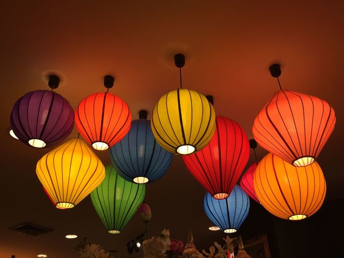 Low angle view of illuminated lanterns hanging in row