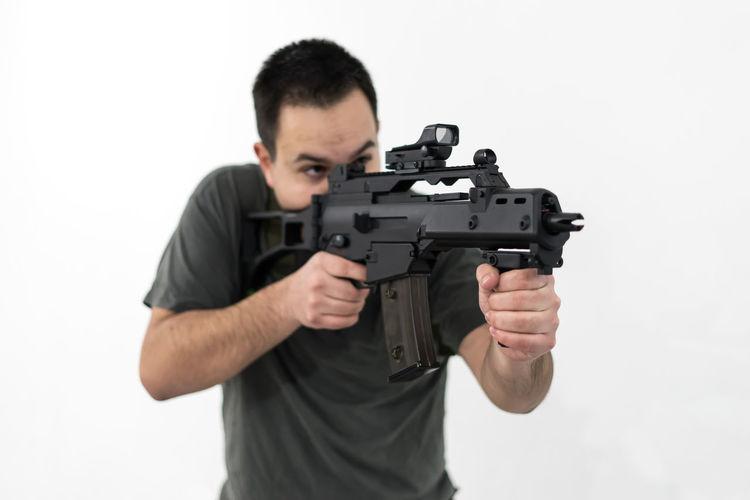 AiRSOFTGUN Airsoft Adult Assault Assault Rifle Assault Rifles Gun Handgun Men Military One Man Only One Person Rifle Shooting Weapon White Background