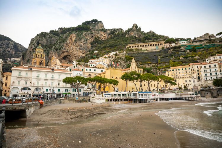 Italy Amalfi  Amalfi Coast Building Exterior Architecture Built Structure Water Mountain City Building Sky Nature Land Residential District Day Town Beach Sea Tree No People Outdoors Travel Destinations TOWNSCAPE