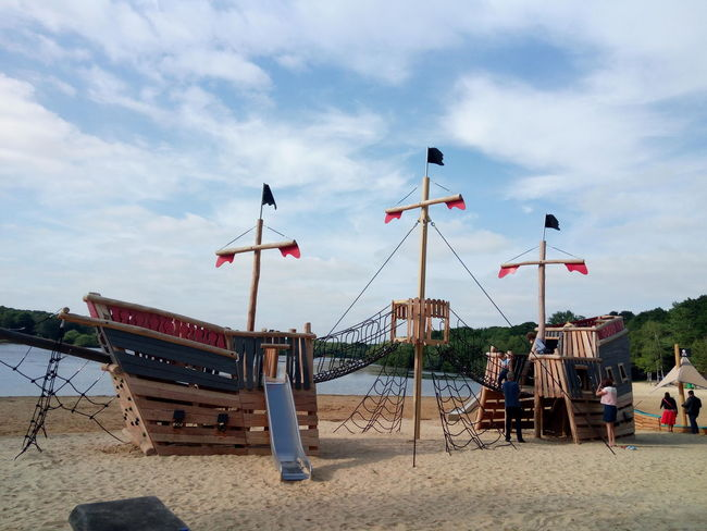 🇬🇧 Beach Photography Ship Model Cool Atmosphere Clear Sky Summer Day Nature_collection Nature Photography Mobilephotography Beach Sand Flag Sky Cloud - Sky