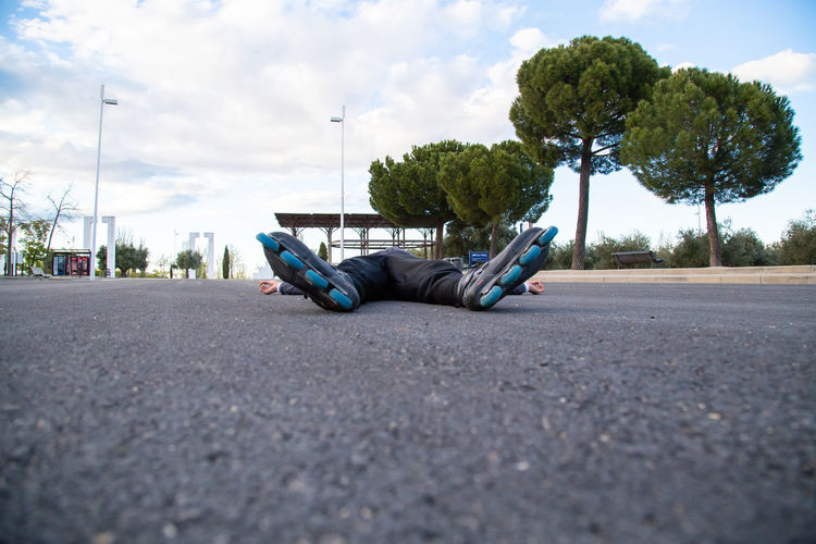 View of man sleeping on road