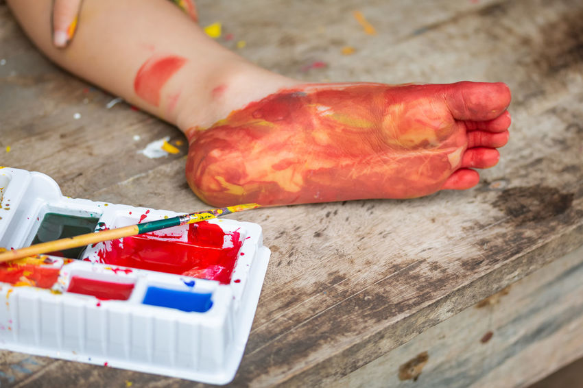 ArtWork Artist Children Colors Desk Foot Funny Grubby Messy Red Art Childhood Colorful Dirty Education Kid Leaning Mucky Painter Play Playing Soiled Stained Water Colors Wooden