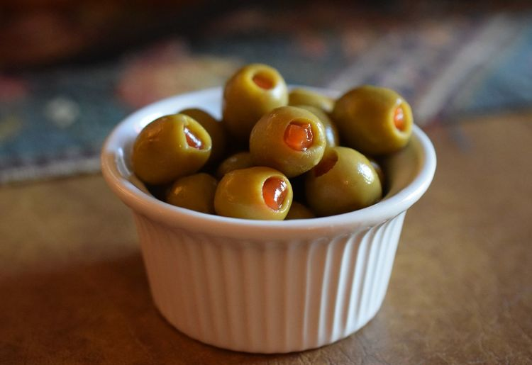 Green Stuffed Olives Bowl Close-up Day Focus On Foreground Food Food And Drink Freshness Healthy Eating Indoors  No People Olives Ready-to-eat Still Life Table