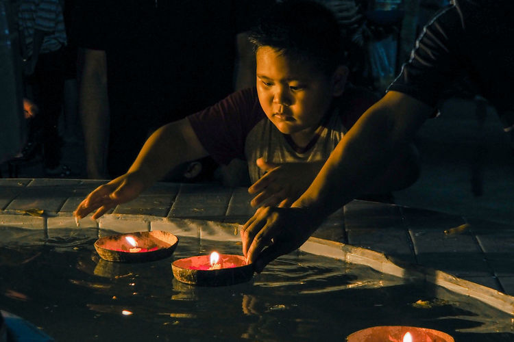 Loy Kratong Festival Makhachkala Night Lights Nightphotography Young Buddhism Burning Fire Flame Hand Handsome Heat - Temperature Indoors  Night One Person People Preparation  Real People Street Night Water Working Young Adult
