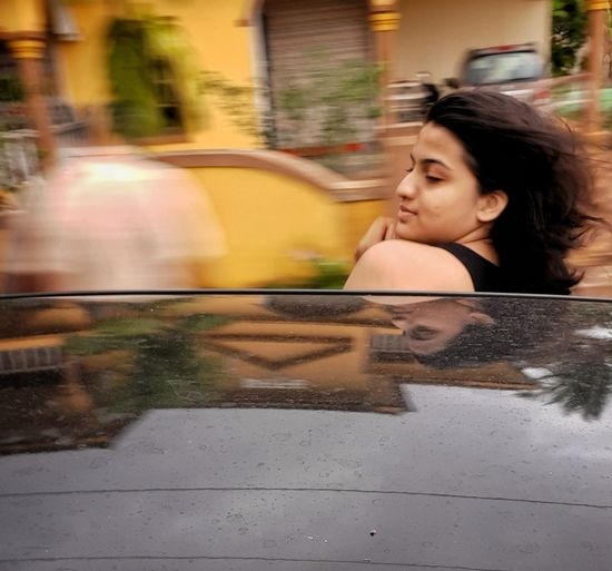 Teenage girl in moving car