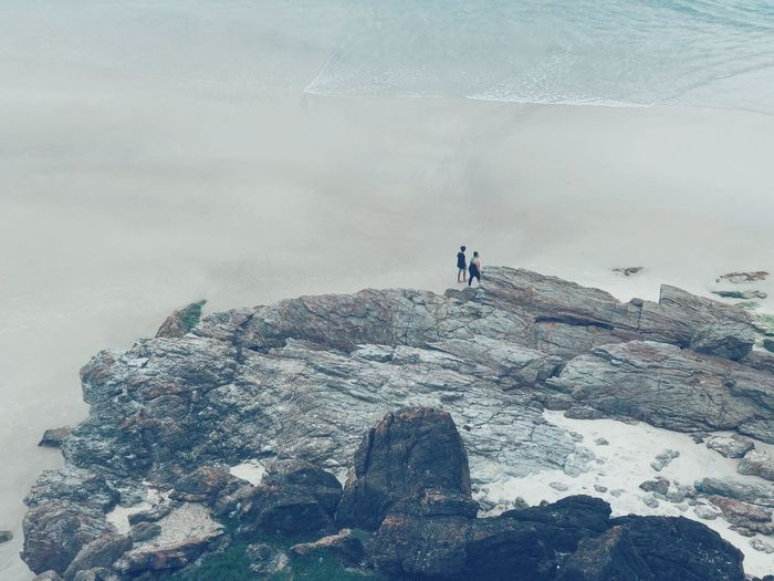 High Angle View Of Man And Woman At Beach