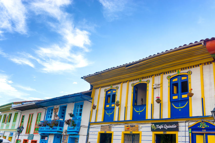 SALENTO, COLOMBIA - JUNE 8: View of storefronts in Salento, Colombia in June 8, 2016 America Architecture Balcony Building Colombia Colonial Colorful Countryside Culture Destination Façade Historic Houses Outdoors Quindío Salento South Street Tourist Touristic Town Travel View Village Window