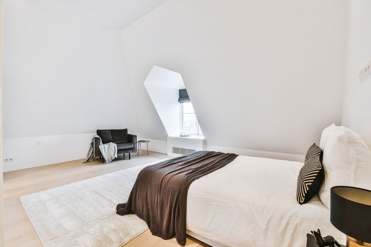 Chairs and table on bed against wall at home