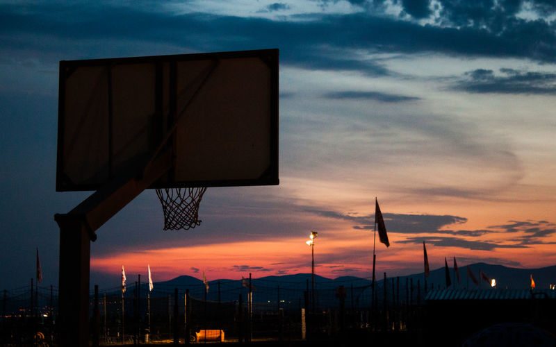 Basketball and Sunset at Grosseto sea Tuscany Italy Sky Cloud - Sky Sunset Orange Color Nature No People Sport Dusk Silhouette Basketball - Sport Low Angle View Beauty In Nature Dramatic Sky Outdoors Scenics - Nature Architecture Lighting Equipment Basketball Hoop Street Tuscany Italy