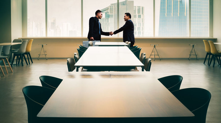 Business Table Men Business Person Meeting Office Businessman Chair Cooperation Males  Board Room Corporate Business Indoors  Adult Business Meeting Seat Two People Occupation Teamwork Real People Coworker